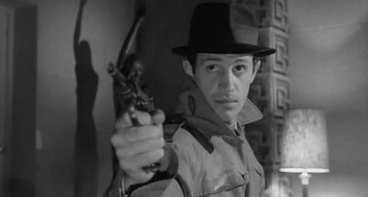 "Jean-Paul Belmondo em ""O Denunciante"" (Le doulos, 1963), de Jean-Pierre Melville"